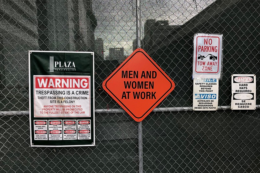 Men & Women at work construction sign